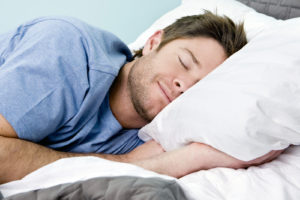 guy sleeping on a pillow
